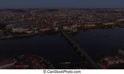 Aerial view of Prague and Charles Bridge in the dusk