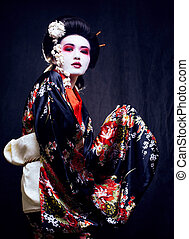 geisha in kimono on black - Young beautiful asian woman's...
