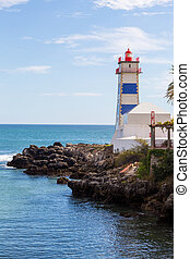 lighthouse on ocean coast in bay cascais in summer day