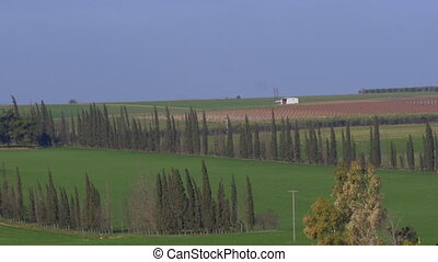 Panoramic shot of rural landscape in Nea Kallikrateia. Village, agricultural fields, countryside houses