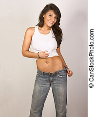 Sexy woman  in jeans and tank-top