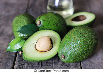 avocado on wooden background - ripe juicy buttery avocado on...