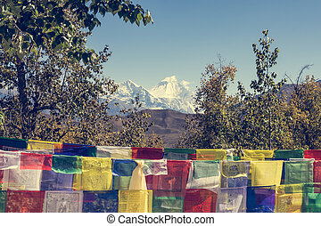 Many buddhist prayer flags blowing in the wind. Dhaulagiri...