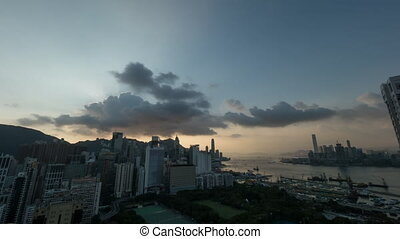 Timelapse of sunset and night coming to Hong Kong -...