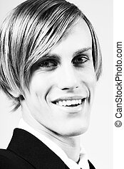 60th style - Portrait of young handsome smiling blonde male...