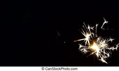 Bengal light against the black - Sparkler Over Black. Gun...
