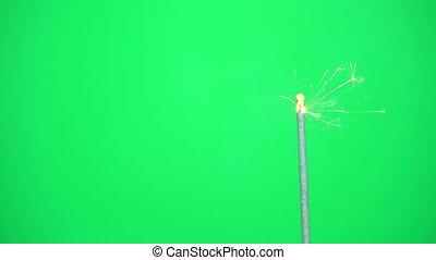 Bengal light against the green. - Sparkler Over Green. Gun...
