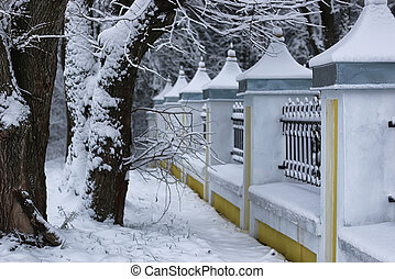 winter wrought fence gates - urban landscape on a sunny...