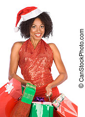Christmas shopping - Attractive tanned female in Santa hat...