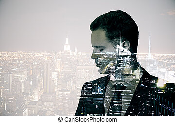 Man on city background - Side view of thoughtful young...