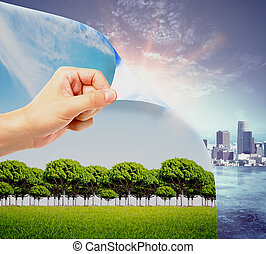 Urbanization concept - Abstract image of hand flipping page...