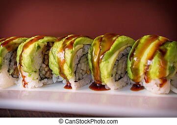 Eel Avacado Dragon Roll - Eel avacado dragon roll with sushi...