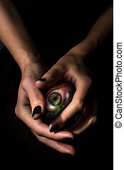 Crystal Ball Third Eye - Female hands hold crystal ball with...