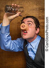 Pig Man Banker - Silly pig man drinking lose change from a...