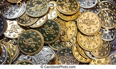 Fake gold and silver coins closeup