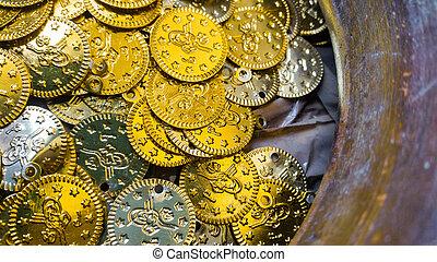 Fake gold and silver coins closeup