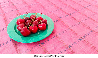 Fresh Cherries Served on a Table