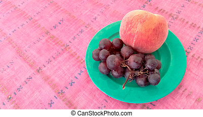 Grapes With Peach in a Plate