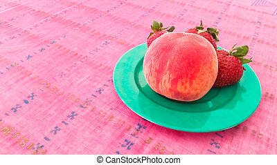 Strawberries and Peach in a Plate
