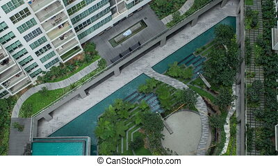 Timelapse aerial shot of landscape area outside apartment...
