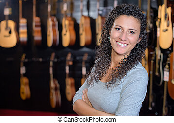 Portrait of woman in guitar shop