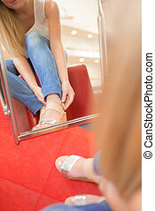 Woman trying on a lovely pair of shoes
