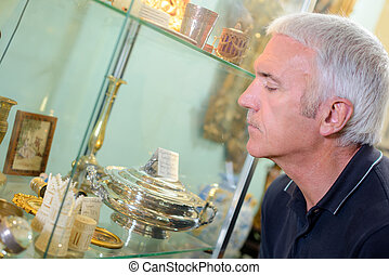 man looking at the artifacts