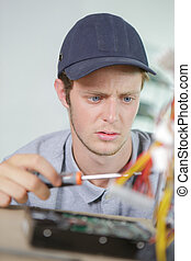 Young electrician with puzzled expression