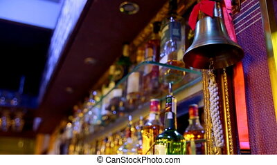 The bartender informs the client about the readiness of...