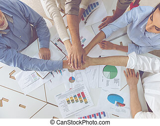 Business people working together - Cropped image of...