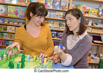 attractive customer and seller at the toy store