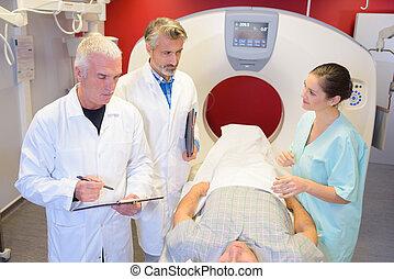 Medics around man in scanner