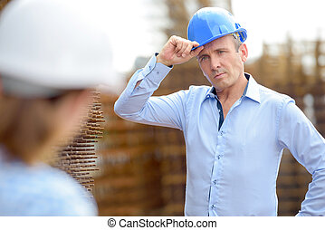 colleagues with hard hats