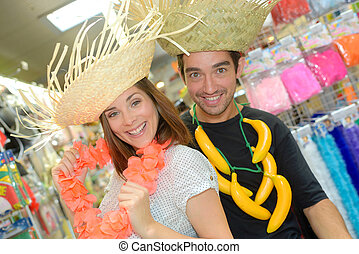 Couple in fancy dress straw hats