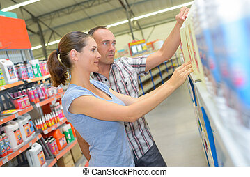 Man and woman choosing product from shelf