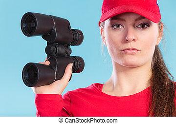 Lifeguard supervising with binoculars. - Lifeguard woman...