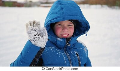 child standing and sweet smiling in winter time. - child...