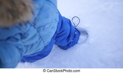 the legs are buried in the snow closeup - feet sink in the...