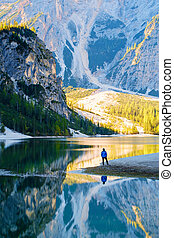 Man Traveler standing alone Braies Lake - Man Traveler...