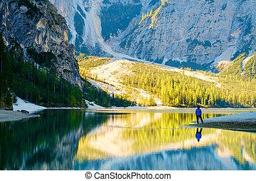 Man Traveler standing alone Braies Lake - Man Traveler...