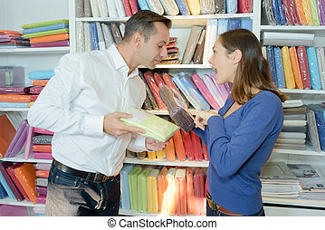 Couple comparing linen in a store