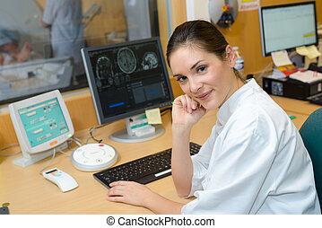 Female nurse analysing scan imagery