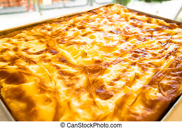 Traditional Turkish homemade Banitsa - pie with cheese in a tray
