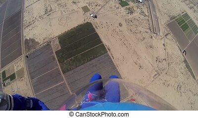 Skydiver parachuting in blue sky. Scenery. Adrenaline. Above arizona. Sands.