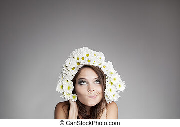 Surprised Thinking Woman With Flower Wreath Looking Up At...