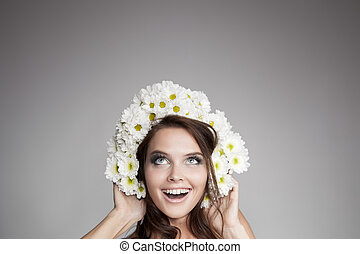 Surprised Smiling Woman With Flower Wreath Looking Up At...