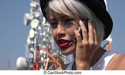 Asian Woman Talking On Mobile Phone