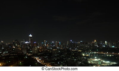 Timelapse of night illuminated Bangkok city, Thailand