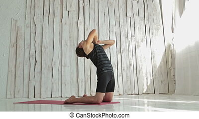 Young sporty man practicing yoga in fitness studio - 3...