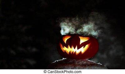 Burning pumpkin on Halloween. Looped - Glowing in the night...